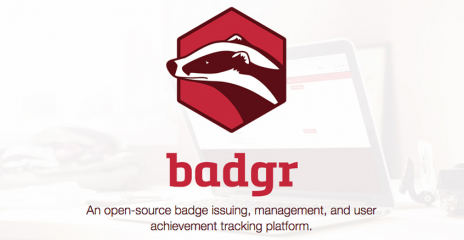 The Badgr logo overlaying a laptop.