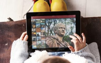 A child uses the digital version of Encyclopedia Britannica on her tablet.