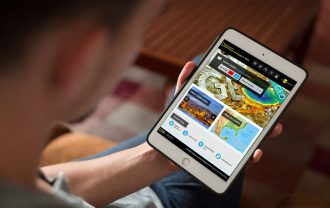 A man uses the National Geographic app on his tablet.